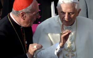 COLOGNE, Germany: Pope Benedict XVI (R) talks to Cologne's Archbishop Joachim Meisner outside Cologne's Cathedral, Germany, 18 August 2005, on the first of his groundbreaking four-day visit to his native Germany, his first visit abroad since his election as pope in April. More than 400,000 young Catholics from nearly 200 countries were set to welcome the new pope to the Catholic stronghold of Cologne for the 20th edition of the World Youth Day celebration. AFP PHOTO FREDERICO GAMBARINI/POOL (Photo credit should read FREDERICO GAMBARINI/AFP/Getty Images)