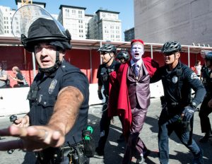 "A protester is taken into custody by LAPD officers during ""This Nightmare Must End: the Trump/Pence Regime Must Go!"" protest in downtown Los Angeles on Saturday, Nov. 4, 2017. (Photo by Ed Crisostomo, Los Angeles Daily News/SCNG)"