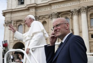 Domenico Giani, lead bodyguard for Pope Francis and head of the Vatican police force, keeps watch as the pope leaves his general audience in St. Peter's Square at the Vatican May 1, 2019. Pope Francis accepted the resignation of Giani Oct. 14, nearly two weeks after an internal security notice was leaked to the Italian press. (CNS photo/Paul Haring) See POPE-GIANI-RESIGNATION Oct. 14, 2019.