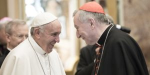 VATICAN CITY, VATICAN - DECEMBER 22: Pope Francis exchanges Christmas greetings with Vatican Secretary of State cardinal Pietro Parolin at the Clementina Hall on December 22, 2016 in Vatican City, Vatican. Pope Francis invited the Roman Curia to embrace the process of reform, telling them Christmas is 'the feast of the loving humility of God, of the God who upsets our logical expectations, the established order'. (Photo by Vatican Pool/Getty Images)