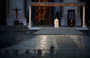 """Pope Francis gives his extraordinary blessing """"urbi et orbi"""" (to the city and the world) in an empty St. Peter's Square at the Vatican March 27, 2020. The blessing was livestreamed because of the coronavirus pandemic. (CNS photo/Guglielmo Mangiapane, pool via Reuters) See POPE-BLESSING-COVID-19 March 27, 2020."""