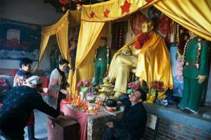 CHINA-Mao_as_Buddha